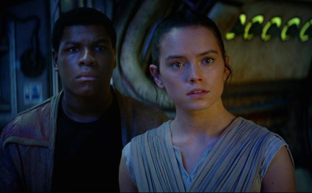 Finn and Rey on the Millennium Falcon from Star Wars: The Force Awakens