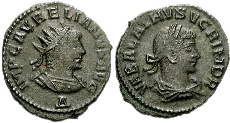 Two faces of an ancient Roman coin, one showing a bearded man wearing a radiate crown, the other showing a young men wearing a wreath.